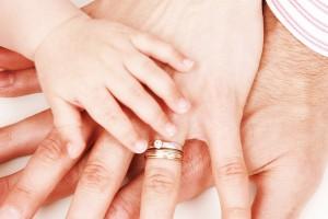 child-parents-hands