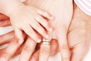 child-parents-hands